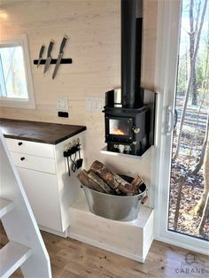 Placement and size of stove. Tiny Farm, Tiny House Big Living, Stove, Kitchen Cook, Stoves, Hearth Pad, Kitchens, Range Cooker