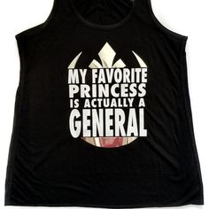 Princess Leia? I think you mean General Organa! If your favorite Princess is actually a butt kicking general, then this shirt is for you! White tank has pink text and gold accents. Black tank has white text and silver accents Tanks fit true to size and have a flowy relaxed fit.