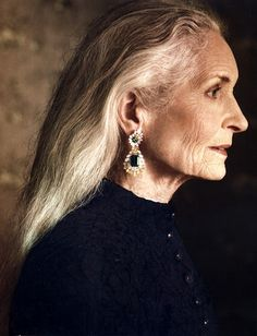 This is Daphne Selfe, aged 83.  Daphne is a model and has never had any sort of plastic surgery.  She's still rockin' the long hair and looks!