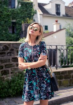 A printed dress and mirrored shades for the win.