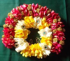 Veni made with real pink ,white & yellow rose petals, kundan applique and artificial gold roses.
