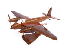 "A beautiful hand carved desktop model of the Mosquito. The model has been carved from solid mahogany. The model comes boxed and is simple to assemble. The wings, tail fins, stand and rotas simply slot into pre-drilled holes on the body of the aircraft. No glue required. Size H 7"", L 13"", W 16"". Visit our website at http://www.thewoodenmodelcompany.co.uk to view the full range of our models."