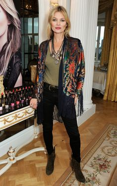 Kate Moss posed at the Rimmel London 180 Years of Cool photo call in London.