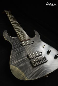 Waghorn Corax 8-string... like the finish colors of the top and back on the arm cut
