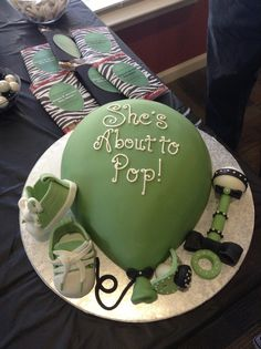 "My Daughter's Baby Shower Cake; the theme ""She's About To Pop"". So pleased and totally delicious. www.stickboyfuquay.com gets all the props."