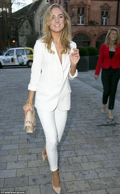 Lovely in white: Kimberley Garner is no stranger to fashion events and she showed up looking decidedly demure in a tight trouser shorts