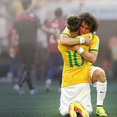 Neymar and David Luiz after the match against Chile in the World Cup 2014.
