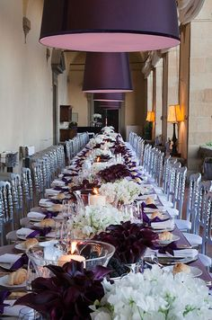 Use of single type of flowers in bouquets togther give a nice clean modern feel. The contrast of deep purple and white create a glamourus table setting.