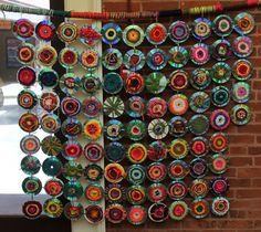 Students in Art with a Heart classes in a Baltimore middle school are creating this beautiful wall hanging using recycled CDs and yarn!