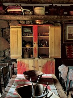 Little Bear Cabin    Like most of the dwellings on the property, the space is equipped with accommodations for as many as eight visitors. Before the rock wall is a 19th-century painted stepback cupboard that was found in the South. On the table is a Santo Domingo dough bowl.