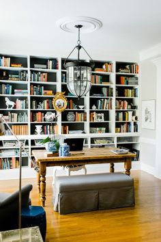 Library Dining Room - built-in bookcase background painted dark color.