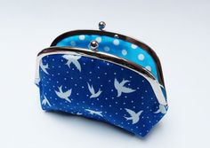 Small blue and white bird fabric cosmetic bag by cheekyleopard