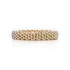 Tiffany & Co. | Schlumberger Rope two-row ring in 18k gold with diamonds in platinum.