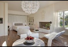 LOVE that chandelier. And the wall hanging above the fireplace. And the bed. And...