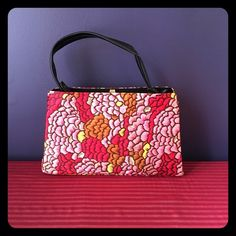Vintage 60's Mod Floral Print Bag This Purse is vintage but it's in like new condition. The strap is vinyl and measures 6 inches in height, the height of bag is 8 inches and the width at the largest area across is 12 inches. Interior has no flaws or markings. Vintage Bags