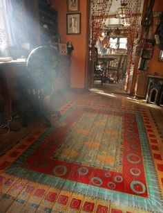"""Good idea for old, scratched wood flooring. Instead of replacing it all, paint area """"rugs"""" on it!"""