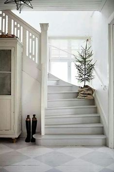 French farmhouse Christmas decor. Simple staircase decor