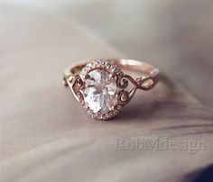 I absolutely love this band with the oval cut center stone. Obviously a diamond and not morganite