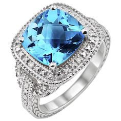 SS Checkered Cushion Cut Blue Topaz and .05 Ctw Round Cut Diamond Ring Size 7