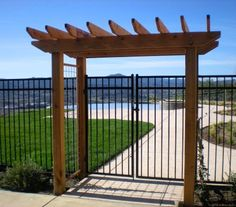 Arbor over pool fence