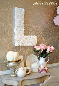 """The beautiful """"L"""" decoration is made from white cupcake liners!"""
