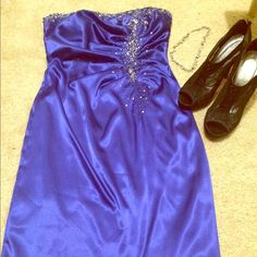 Breath taking blue sequin dress! Knee length dark blue dress with beautiful sequins and lace along the top and down the left side. Worn twice Dresses Strapless