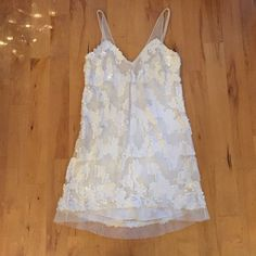 BRAND NEW white sequin dress ✨ Never been worn! Sheer straps and hem with sequins patterned on front and back. Urban Outfitters Dresses