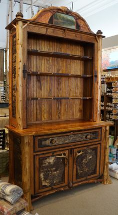 www.lpostrustics.com Adirondack rustic bookcase/hutch made with reclaimed wood from Camp Dudley.  Beautiful oil painting by Joann Post.