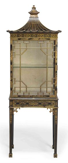 A BLACK AND GILT JAPANNED CHINA CABINET - CIRCA 1900