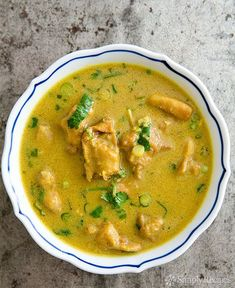 Delicious chicken peanut curry with boneless chicken, curry, peanut butter, green onions, garlic, ginger, and chiles. Inspired by an African dish. So good! On SimplyRecipes.com