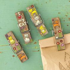 I Love My Cat Happy Clips - Our cat happy clip sets make purrrr-fect little gifts. Wooden chip bag clips with tiny cats and 'I love My Cat' painted on both sides, and rhinestone embellishments. Multi-functional, and made just for cat-lovers!