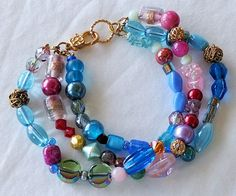 """Three-Strand Multicolored Beaded Bracelet with Gold Tone Lobster Clasp, 7"""""""