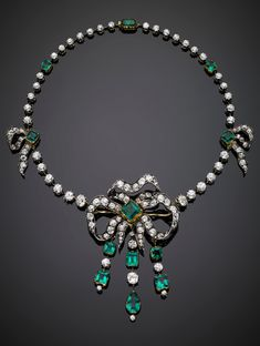 An antique/antique style yellow gold, silver, diamond, and emerald necklace