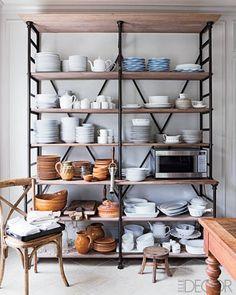 open shelves / Roger Davies for Elle Decor >> something like this for the living room shelves? Dining Room Shelves, Kitchen Shelves, Kitchen Storage, Kitchen Racks, Cupboards, Pipe Shelves, Kitchen Organization, Kitchen Display, Metal Shelves