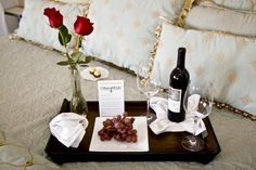 A welcome tray at the Henderson Park Inn with roses, grapes, and a bottle of wine.