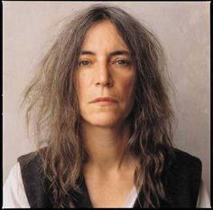 Patti Smith hall of famer and writer - in two of her books she describes wearing her dad's jacket everywhere - look at this black vest over white shirt - monochrome for her authentic to the core personality