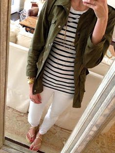 Black n white stripes under an olive green 'army look' jacket, white pants, long station necklace, sandals. Cute!