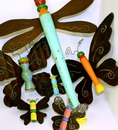 Butterfly and dragonfly garden art from chair legs