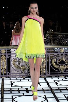 Atelier Versace Spring 2013 Couture: Neon is present in this dress! I love the pleat detailing and how it looks like fringe.