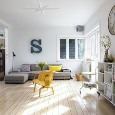 grey couch with white walls