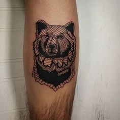 delightful grizzly bear tattoo with the serious gaze