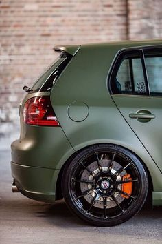 VW Golf GTI love the orange against this gorgeous green