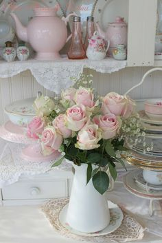 Pretty flowers but also loving the teapots and china in the background!