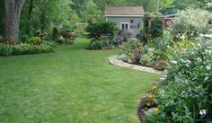 J & Ds garden: view of backyard from house. Yard is divided, right side full to partial sun, left side partial to f
