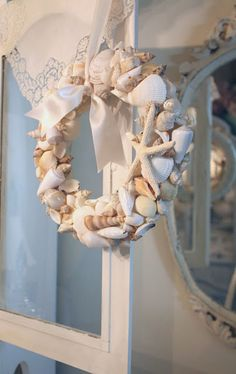 Seashell wreath made with dollar tree foam foundation wrapped with ribbon then glue gunned shells