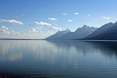 The Grand Tetons at sunset, against the blue sky and a very blue Jackson Lake. #naturephotography #photography #grandteton #jacksonlake #wyoming #nationalparks