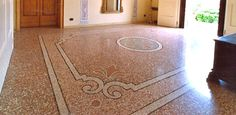 Sala d'ingresso realizzata con terrazzo alla veneziana