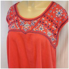 "AMERICAN EAGLE OUTFITTERS  Open Back Med AMERICAN EAGLE OUTFITTERS  Open Back, size Medium, blue and white embroidered on orange semi-crinkled material, boxy fit, scoop neck, not a crop top but rather on the shorter lenght side, 52% cotton,  48% viscose,  decoration 100% polyester,  23"" length shoulder to hem, 20"" bust laying flat American Eagle Outfitters Tops"