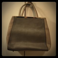Taupe and gray faux leather purse Taupe and gray with gold detailing. Just fab brand and gently used. Shoulder strap included. Also has snaps on the inside corners to create a chicer shape or unsnap for more space. JustFab Bags Shoulder Bags