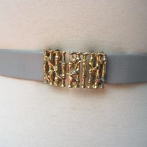 """Chic! vintage GREY Faux Leather Wrap Strap Belt with GOLD Tone Metal Bird Fence Buckle Belt; adjustable DESIGNER: vintage Marked SIZE: will fit waist up to 34""""; width 1""""  Material: metal, leather Condition: Great Vintage Condition  Additional belts are available if you are looking for a spe..."""
